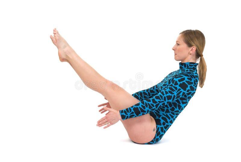 Gymnast sitting balance. Gymnast sitting on floor keeping balance stock image