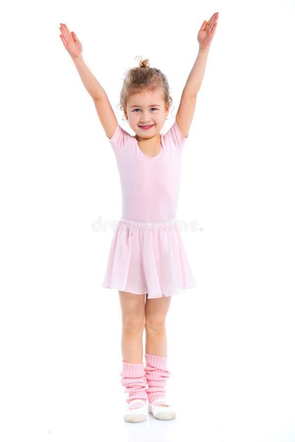 Gymnaste de fille d'isolement sur un fond blanc image libre de droits