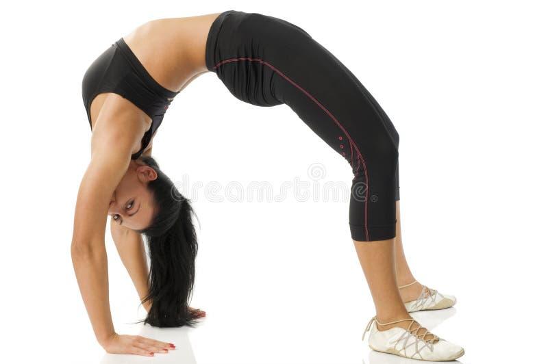 Gymnastic girl doing bridge stock photos