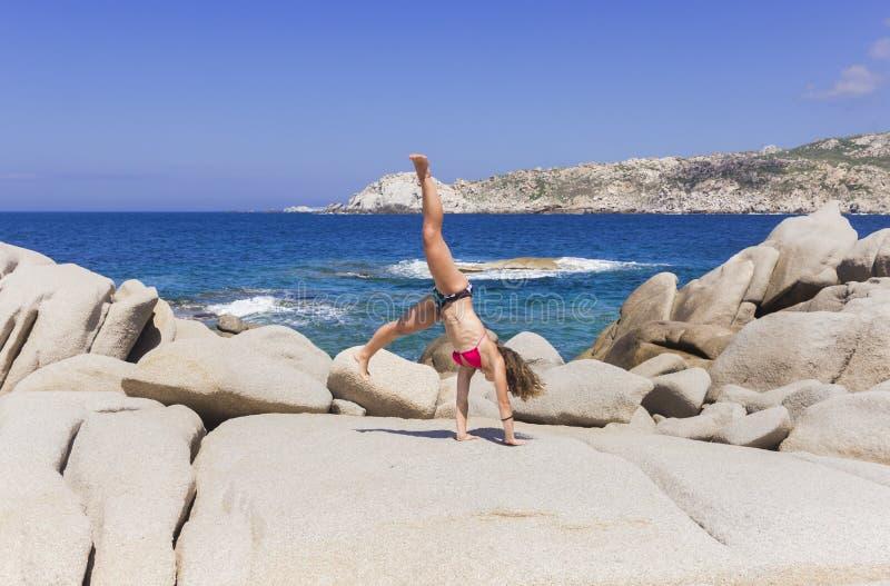 Gymnastic near the sea stock photo