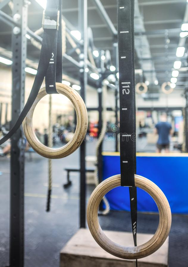 Free Gymnastic Rings In The Crossfit Zone In The Gym Stock Image - 144336231
