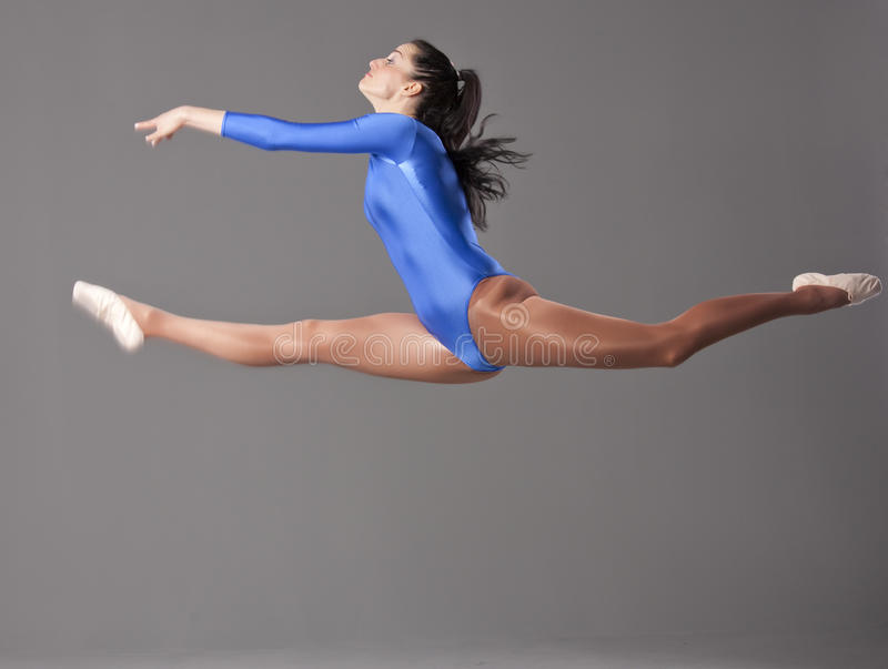 Gymnastic splits in jump stock images