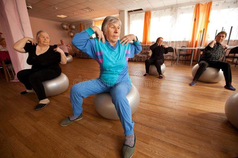 Gymnastics with ball for eldery stock image