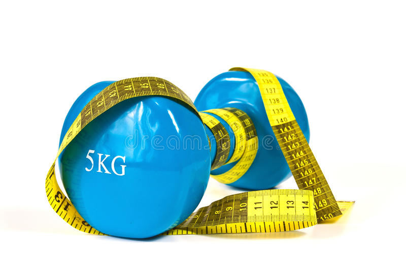 Gymnastics dumbbell and tape measure. On a white background royalty free stock photo