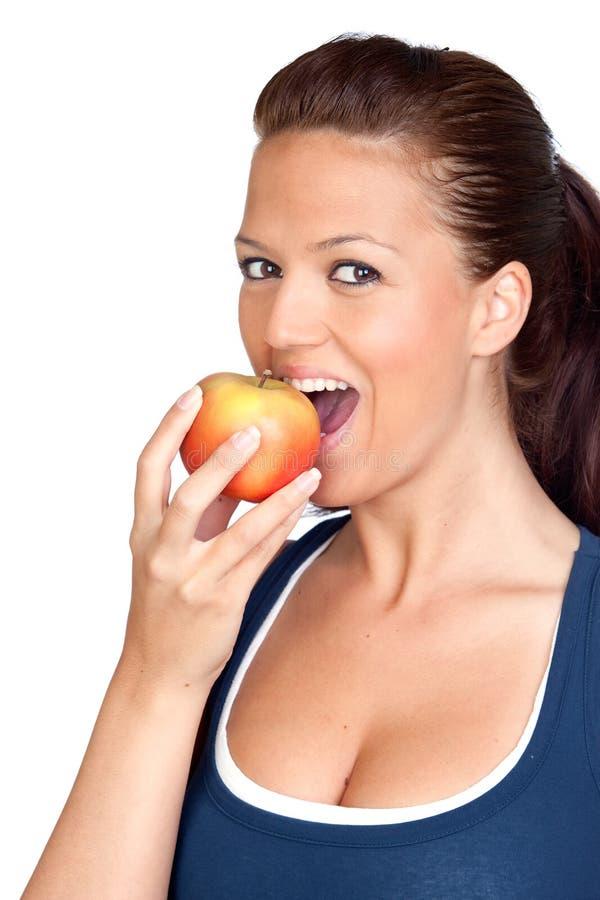 Gymnastics girl eating apple stock images
