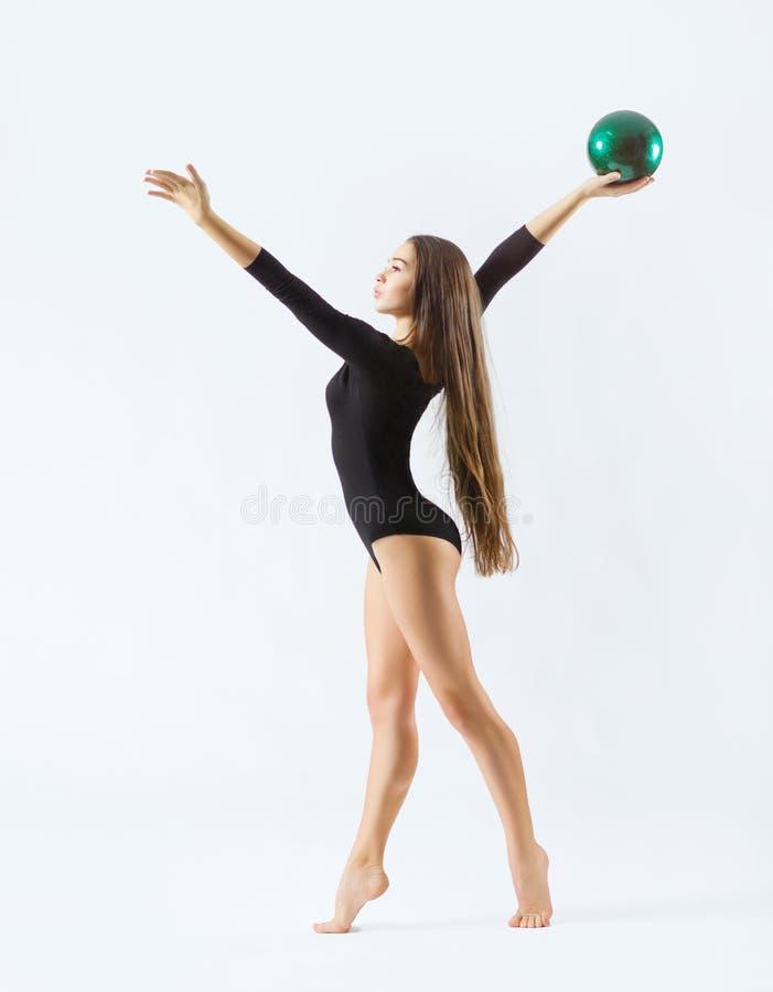 Gymnastisk förlovad konst för ung flicka arkivfoton