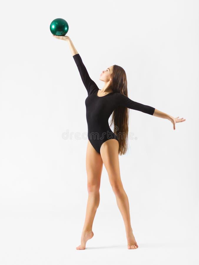 Gymnastisk förlovad konst för ung flicka royaltyfri foto