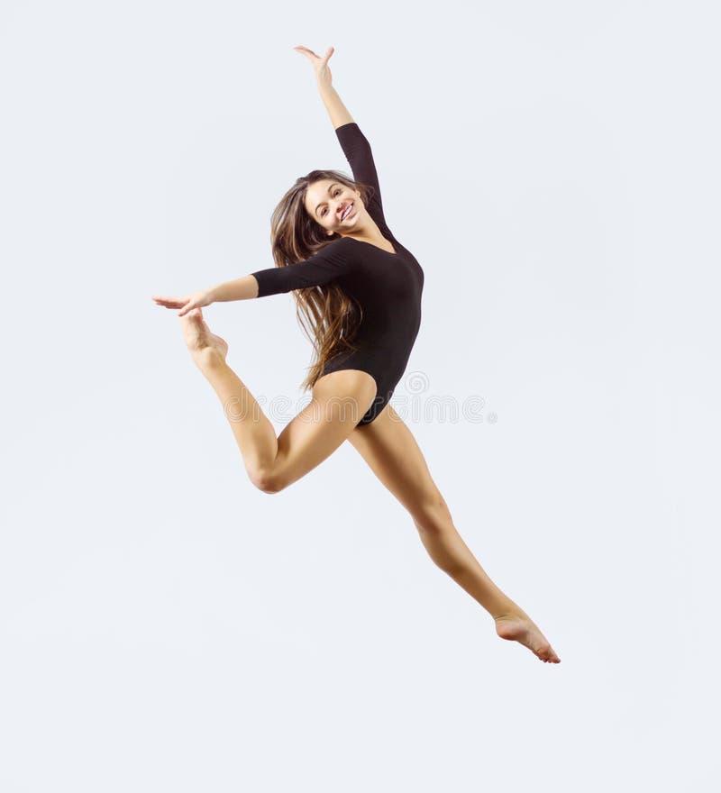 Gymnastisk förlovad konst för ung flicka arkivbilder