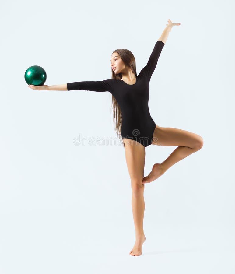 Gymnastisk förlovad konst för ung flicka royaltyfria bilder