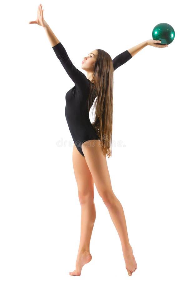 Gymnastiska förlovade konster för ung flicka royaltyfri bild
