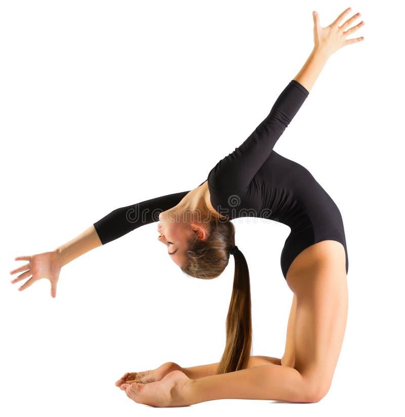 Gymnastiska förlovade konster för ung flicka royaltyfri fotografi