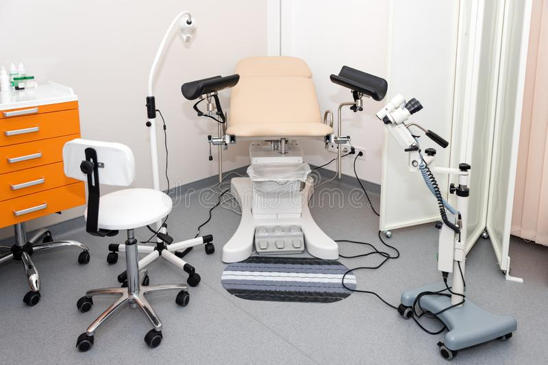 Gynecological cabinet with chair and other medical equipment in modern clinic. Equipment medicine, medical furniture. Hospital, genicology, women`s stock image