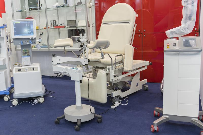 Gynecological chair and other medical equipment in a gynecological office.  stock photography