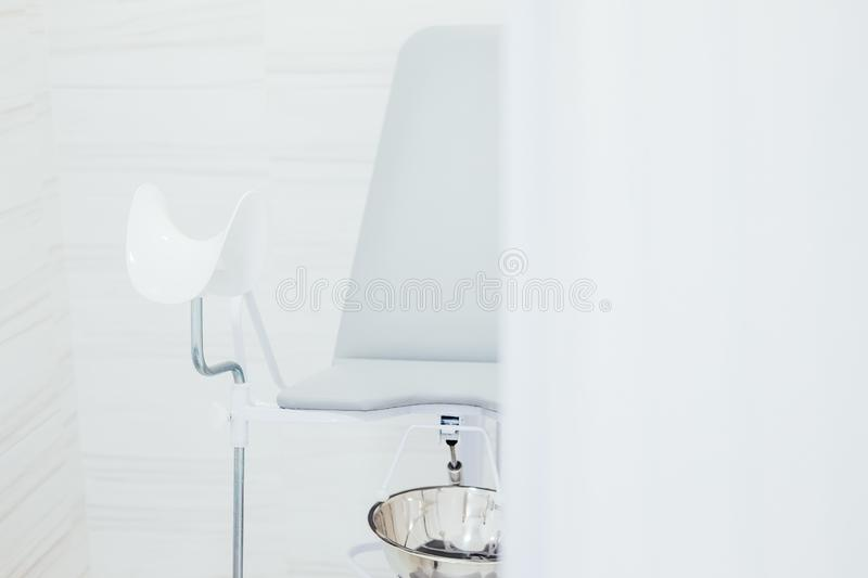 Gynecological examination chair at the clinic royalty free stock image