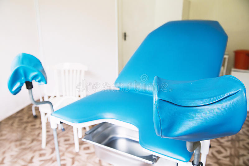 Gynecological room with chair and equipment stock images
