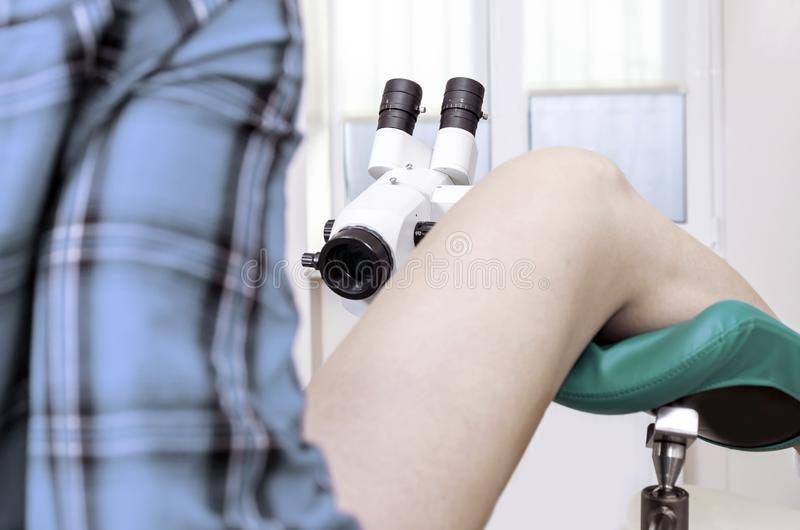Gynecological room gynecologist chair equipment legs female lens microscope royalty free stock photo