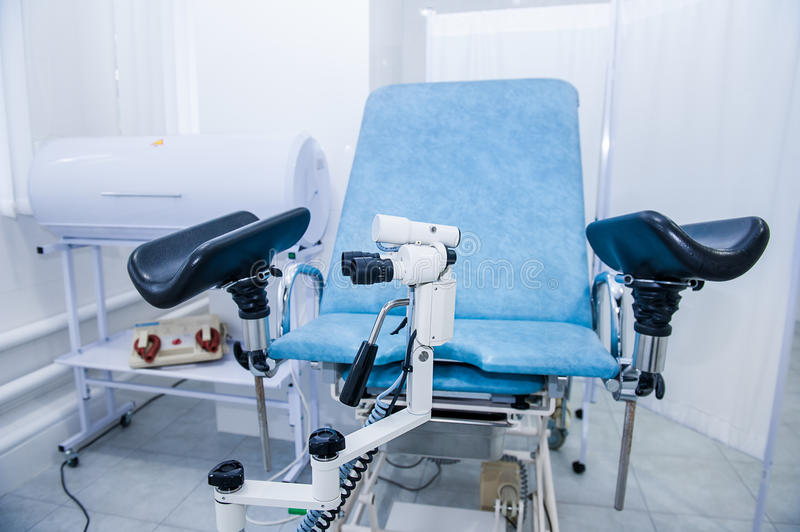 Gynecological surgery room with chair and equipment. Medical and Healthcare concept. Selective focus stock images