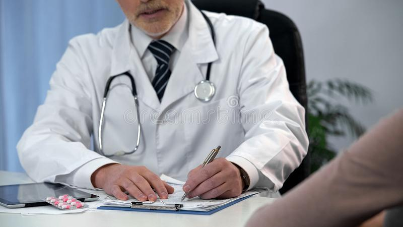 Gynecologist consulting female patient, prescribing medication, women's health. Stock photo stock images