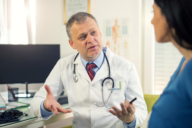 Gynecologist doctor and pregnant woman. Gynecologist doctor and pregnant women meeting at hospital stock photos