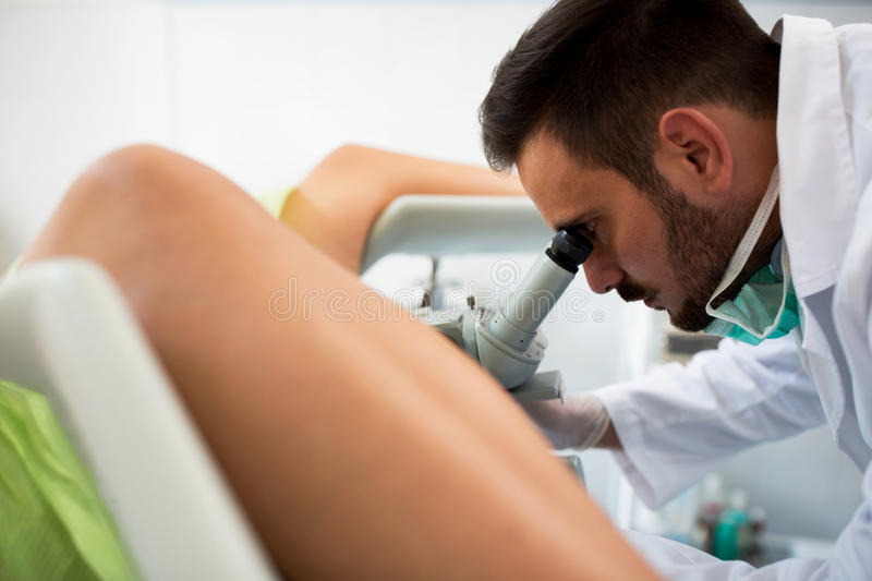 Gynecologist examining a patient with a colposcope. Check up healthcare patient royalty free stock photos