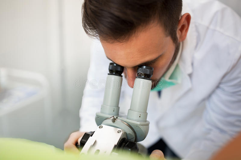 Gynecologist examining a patient with a colposcope. Check up healthcare patient stock image