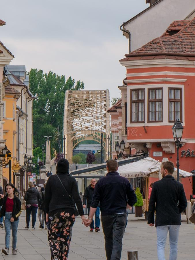 Gyor Hungary 05 07 2019 young people are walking in gyor downtown background with Kossuth bridge royalty free stock images