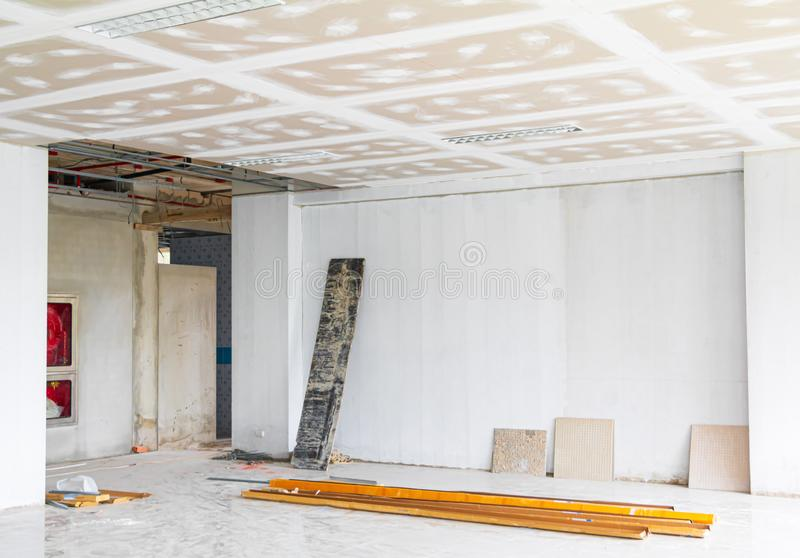 Gypsum board ceiling structure and plaster mortar wall painted foundation white decorate interior room in building construction. Site stock image