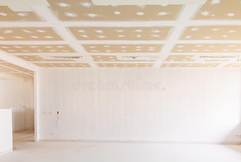 Gypsum board ceiling structure and plaster mortar wall painted foundation white decorate interior room in building construction. Site stock photo