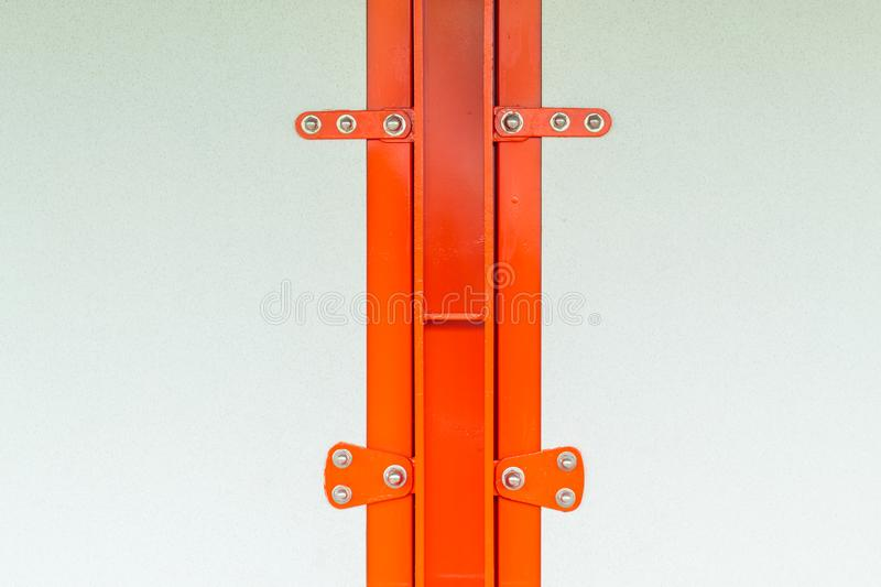 Gypsum panels fastened with screws to a steel structure Orange stock photos