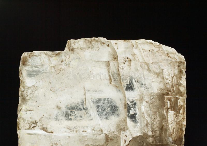 Gypsum plaster crystal mineral displaying its optic properties on black background royalty free stock photo