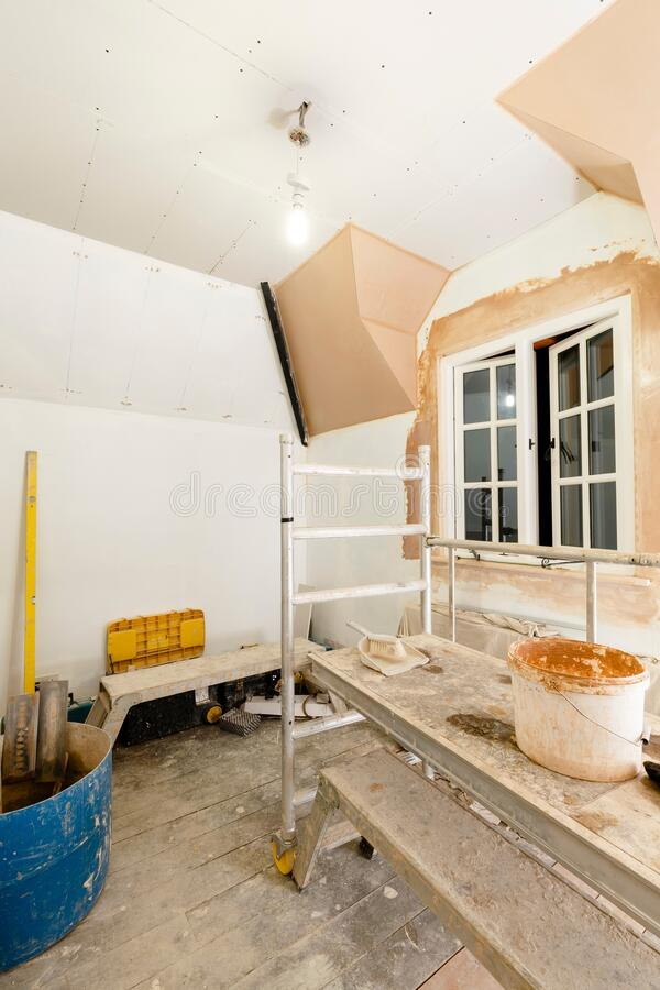 Gypsum plasterboard drywall installation in UK home interior royalty free stock image
