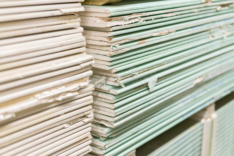 Gypsum plasterboard in the pack. The stack of gypsum board preparing for construction. Pallet with plasterboard in the building stock photography