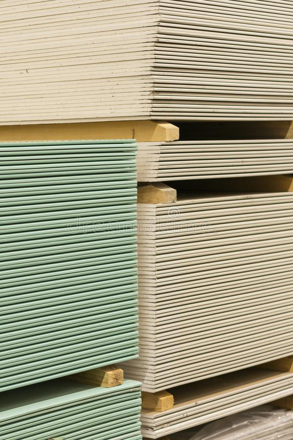 Gypsum plasterboard in the pack. The stack of gypsum board preparing for construction. Pallet with plasterboard in the building. Store. Construction Materials royalty free stock images