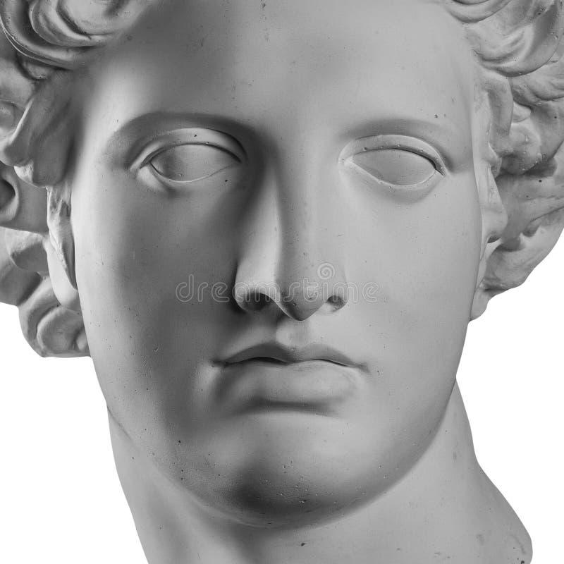 Gypsum statue of Apollo`s head. Isolated stock photo
