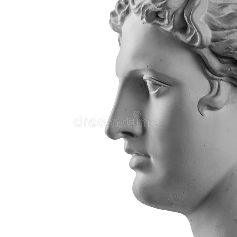 Gypsum statue of Apollo`s head. Isolated stock image