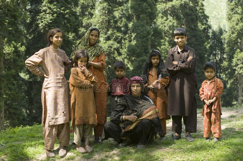 Aru Valley, Pahalgam. Kashmir, India -  August 02, 2011: Gypsy family of Gujjar ethnicity. Gypsy family of Gujjar ethnicity in the Aru Valley, border of India stock images