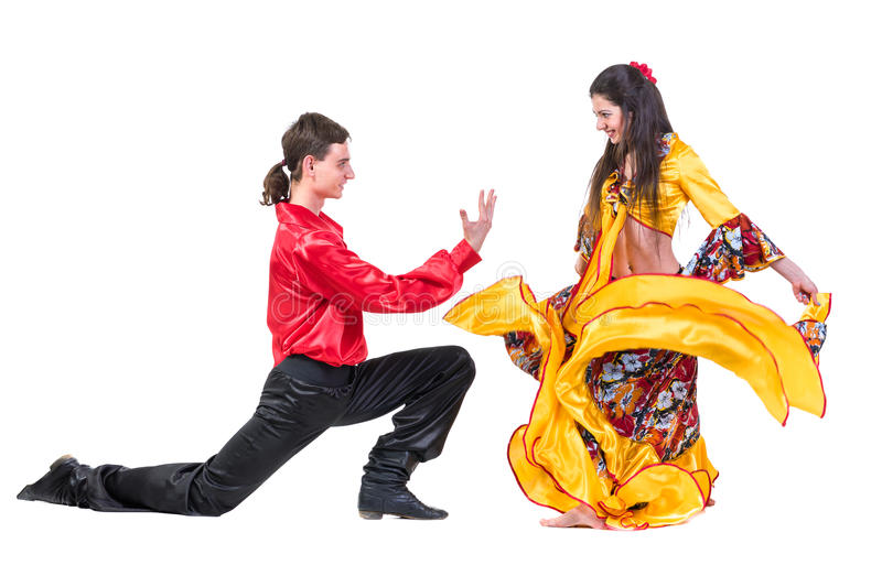 Gypsy flamenco dancer couple. Isolated on white in full length royalty free stock image