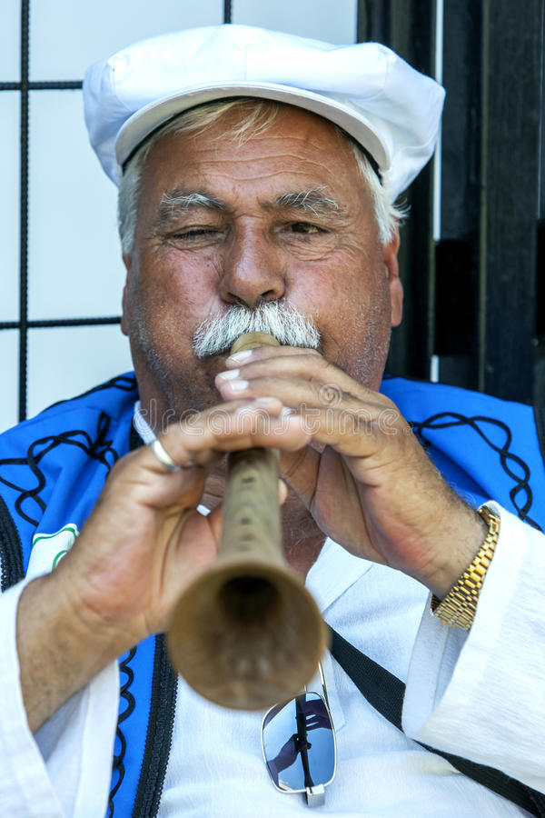 A gypsy flute player performs at the Kirkpinar Turkish Oil Wrestling Festival in Edirne in Turkey. royalty free stock photography