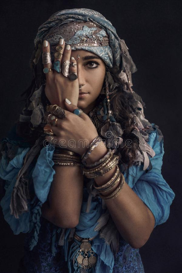 Gypsy style young woman wearing tribal jewellery portrait stock images