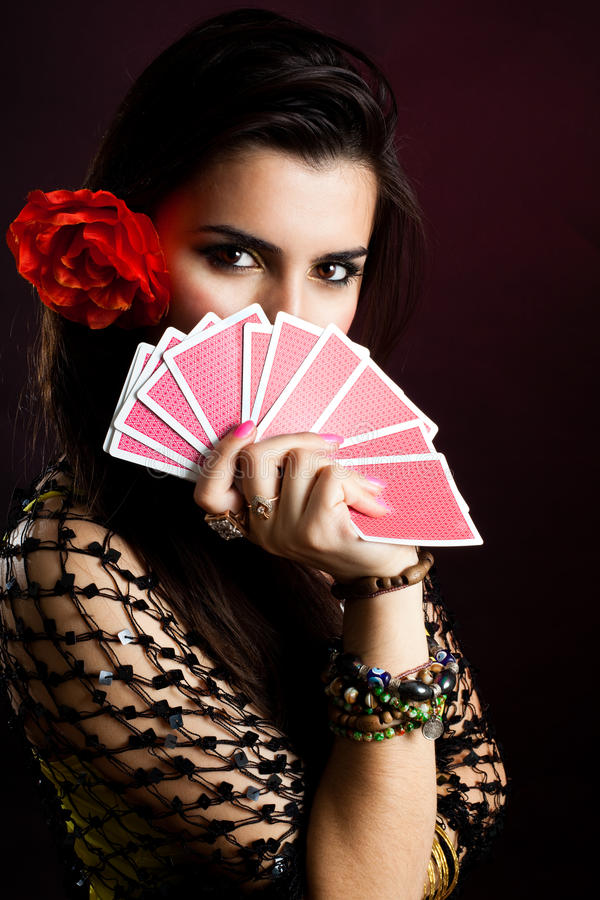 Gypsy woman with fan of cards. And mysterious look stock photography