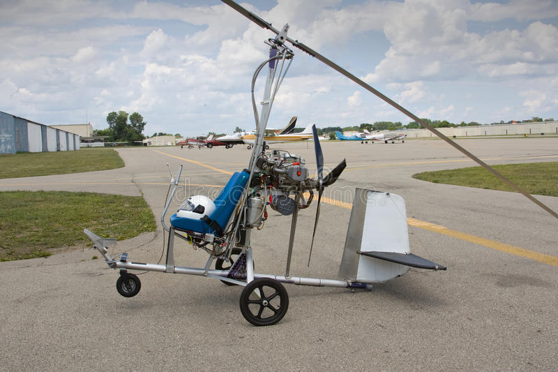 Gyrocopter. A handbuilt gyrocopter ultralight aircraft on an airfield royalty free stock photo