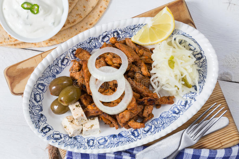 Gyros with Tzatziki Coleslaw olives and feta cheese stock images
