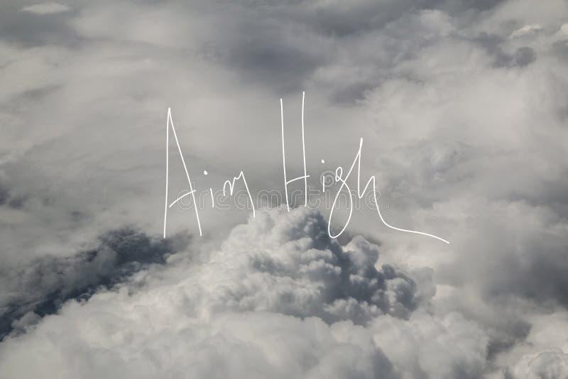 Högt motto för syfte över molnen arkivfoto