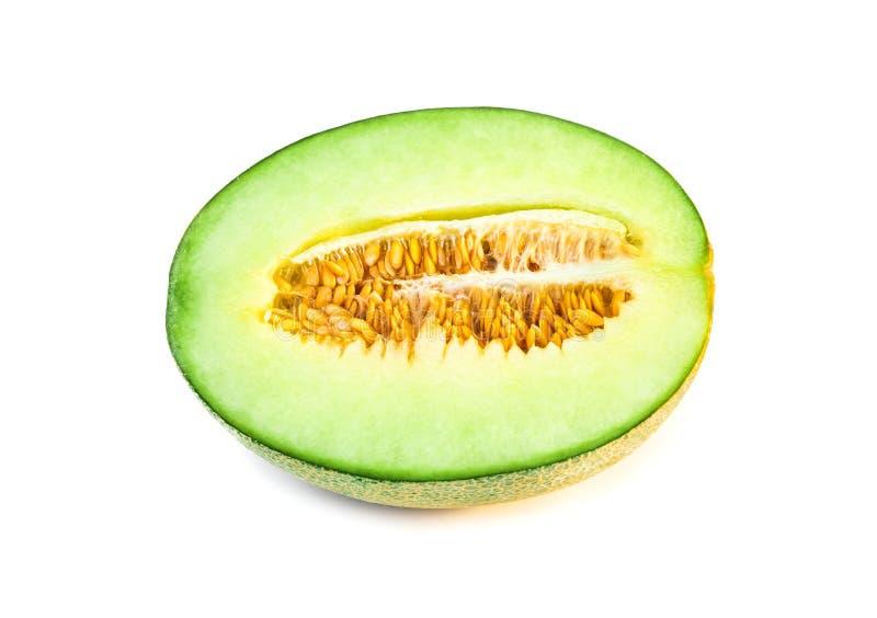 Hälfte der frischen Frucht der Melone lokalisiert auf weißem Hintergrund stockbild