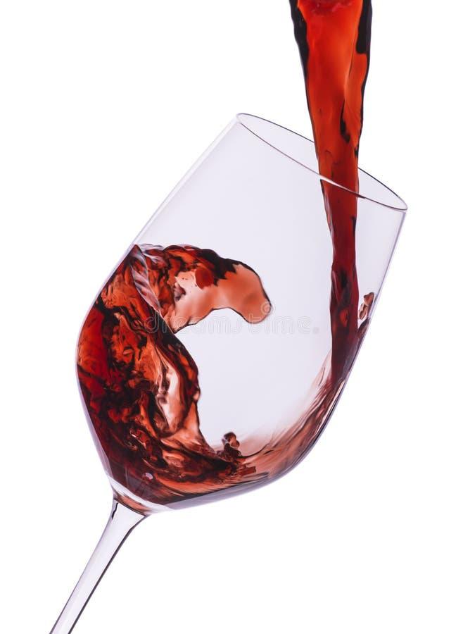 Hällande closeup för rött vin arkivbild