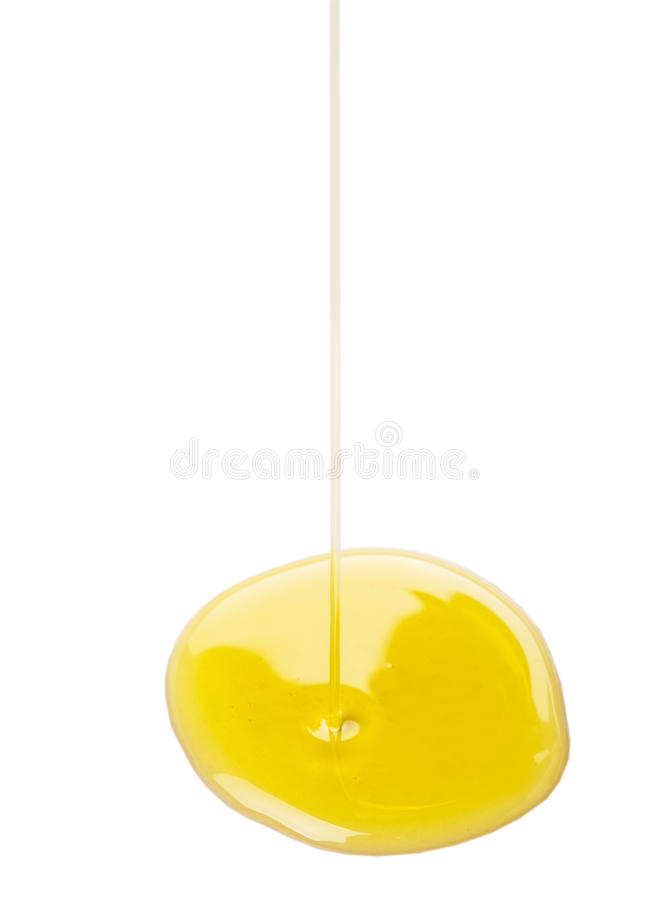 Hällande Olive Oil On Surface X arkivfoto