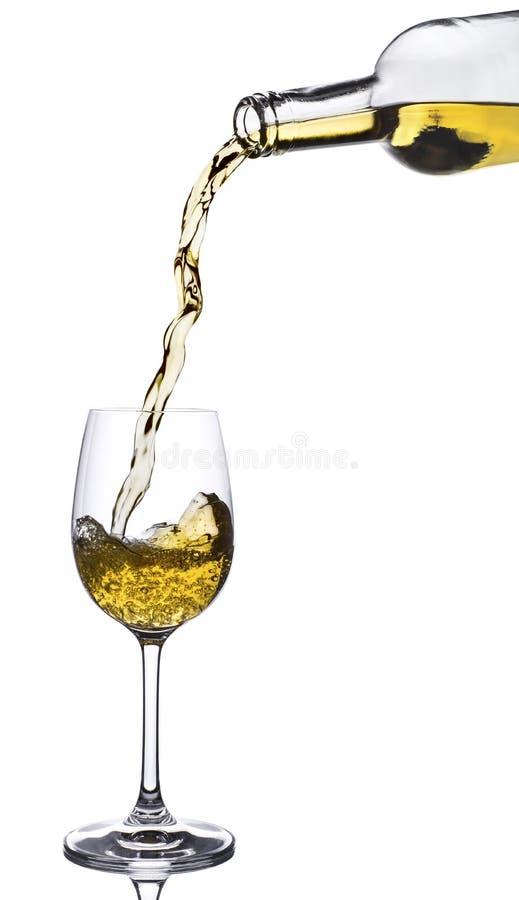 hällande vit wine arkivfoto