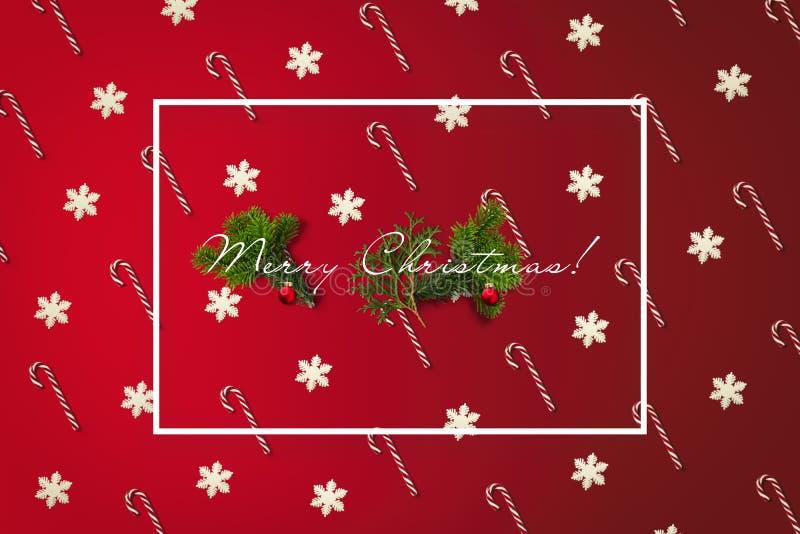 Hälsningkort för glad jul med den vita gränsen Semestra kortet med rottingar royaltyfri foto