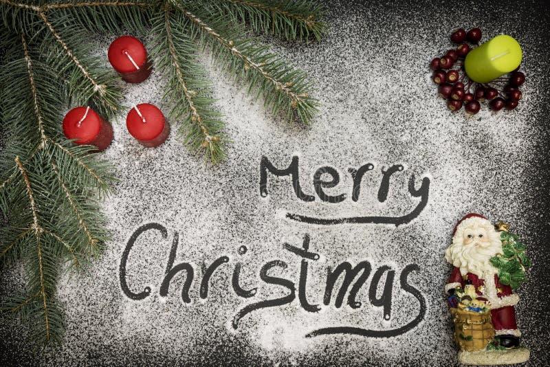 Hälsningkort med festlig garnering och text - glad jul royaltyfria foton