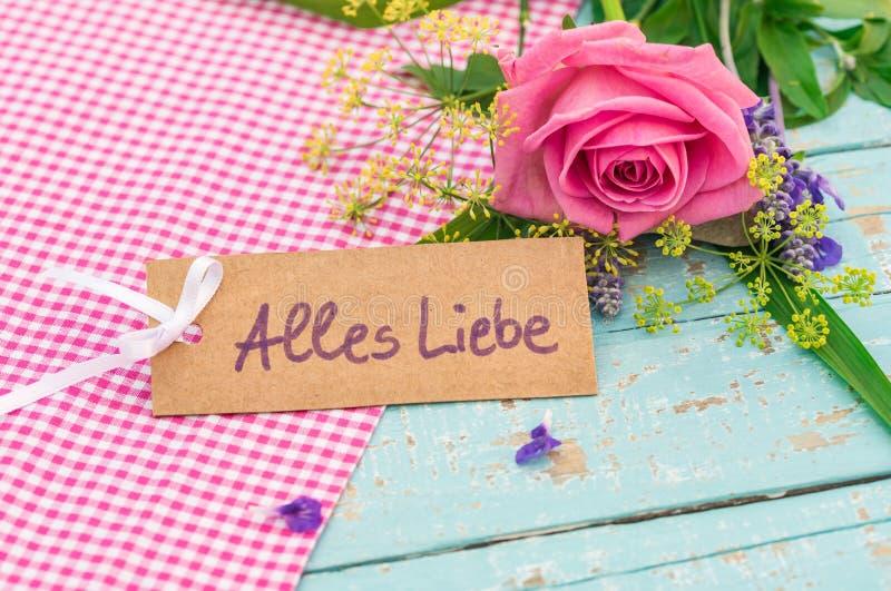 Hälsningkort med tysk text, Alles Liebe, hjälpmedelförälskelse dag för för moder` s för dag eller för valentin för ` s royaltyfri fotografi